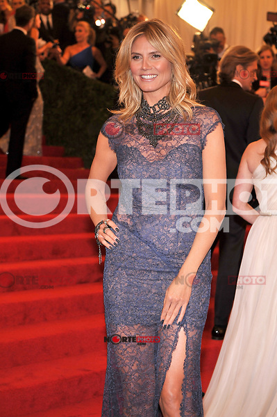Heidi Klum at the 'Schiaparelli And Prada: Impossible Conversations' Costume Institute Gala at the Metropolitan Museum of Art on May 7, 2012 in New York City. ©mpi03/MediaPunch Inc.