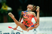 Maryia Yushkevich of Belarus split leaps with clubs at 2006 Portimao World Cup of Rhythmic Gymnastics on September 10, 2006 at Portimao, Portugal.  (Photo by Tom Theobald)