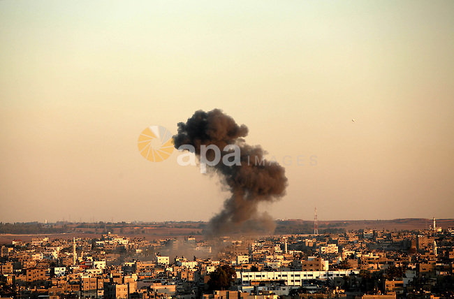 Smoke rises after an Israeli air strike in Gaza city Nov. 15, 2012. The Israeli air force continued striking Hamas targets in the Gaza Strip on Wednesday, after killing 15 people, including al-Jaabari and at least 15 civiliansd. Photo by Majdi Fathi