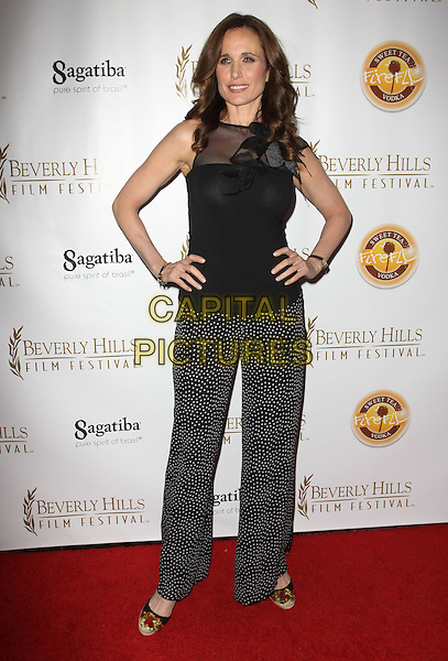ANDIE MACDOWELL.10th Annual International Beverly Hills Film Festival - Opening Night held At The Clarity Theatre,  Beverly Hills, California, USA, .14th April 2010..full length black and white sleeveless flower corsage top hands on hips polka dot trousers wide leg ankle strap wedges espadrilles sheer mesh .CAP/ADM/KB.©Kevan Brooks/AdMedia/Capital Pictures.
