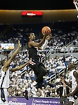 San Diego State's Winston Shepard goes up for a shot against Nevada defenders Deonte Burton, left, and Jerry Evans, Jr. during an NCAA men's basketball game in Reno, Nev., on Wednesday, Jan. 23, 2013. San Diego State won 78-57. (AP Photo/Cathleen Allison)
