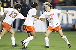 08 November 2013: Virginia's Emily Sonnett (16) celebrates her goal with Morgan Stith (4) and Molly Menchel (13). The University of Virginia Cavaliers played the Virginia Tech Hokies at WakeMed Stadium in Cary, North Carolina in a 2013 NCAA Division I Women's Soccer match and the semifinals of the Atlantic Coast Conference tournament. Virginia Tech won the game 4-2.
