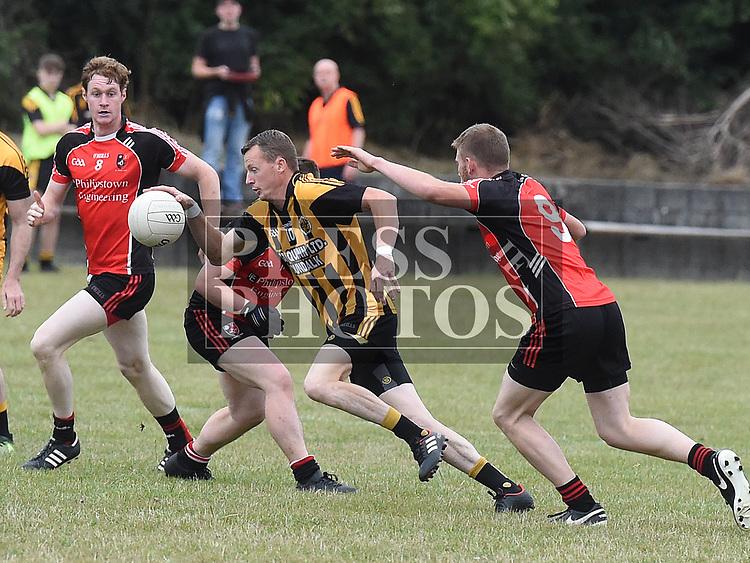 St Kevins Seanie Crosbie, Sean Callan Na Piarsaigh Mark Larkin. Photo:Colin Bell/pressphotos.ie