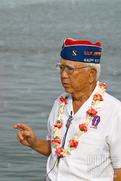 A World  War II veteran and Pearl Harbor Survivor tells his story to journalists on the anniversary of the Japanese invasion, Dec 7th.  Pearl Harbor Naval Base, Oahu.
