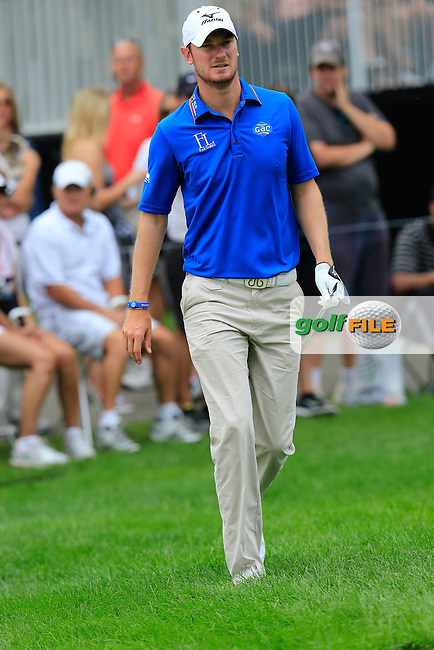 Chris Wood (ENG) walks to the 13th green during Friday's Round 1 of the 2013 Bridgestone Invitational WGC tournament held at the Firestone Country Club, Akron, Ohio. 2nd August 2013.<br /> Picture: Eoin Clarke www.golffile.ie