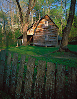 Great Smoky Mts. National Park, TN/NC<br /> Evening light falls on the wooden fencerow bordering the grounds and house of the Tipton Place in Cades Cove