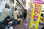 People line up to buy lottery tickets on the first day of sale for the annual year-end jumbo lottery on November 27, 2017, Tokyo, Japan. From early morning buyers lined up to buy their lottery tickets at the 1st ticket window in Ginza, which is well known for producing big winners. This year's top prize is 1 billion Yen (approx. US$ 8.9 million) and each ticket costs 300 Yen (US$2.69). Ticket sales continue across the country until December 22. (Photo by Rodrigo Reyes Marin/AFLO)