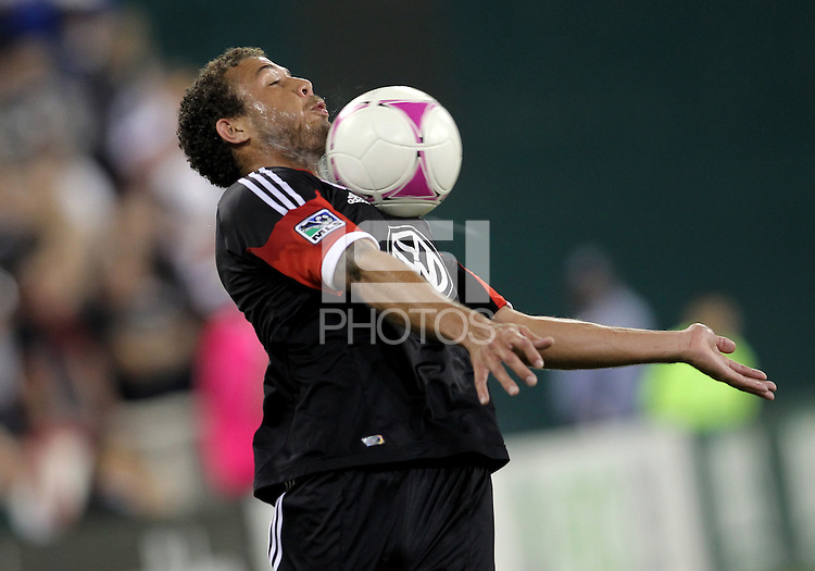 WASHINGTON, DC - OCTOBER 20, 2012:  Nick DeLeon (18) of D.C United hauls in a high ball against the Columbus Crew during an MLS match at RFK Stadium in Washington D.C. on October 20. D.C United won 3-2.