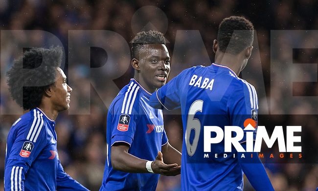 Baba Rahman of Chelsea congratulates goal scorer Bertrand Traore of Chelsea during the FA Cup 5th round match between Chelsea and Manchester City at Stamford Bridge, London, England on 21 February 2016. Photo by Andy Rowland.
