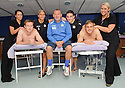Julie Newall (left) and Linda Beattie from Cumbernauld college welcome Queen of the South's Chris Higgins, Gavin Reilly, Sandy Clark, Nicky Clark and Ryan McGuffie, who are being treated to a massage as a treat for putting Rangers out of the Ramsden Cup ...