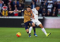(L-R) Hector Bellerin of Arsenal against Jefferson Montero of Swansea during the Barclays Premier League match between Swansea City and Arsenal at the Liberty Stadium, Swansea on October 31st 2015