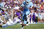 17 September 2016: UNC's Elijah Hood (34) is tripped up by JMU's Rashad Robinson (22). The University of North Carolina Tar Heels hosted the James Madison University Dukes at Kenan Memorial Stadium in Chapel Hill, North Carolina in a 2016 NCAA Division I College Football game.
