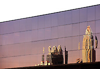 Bank of America tower and Hearst Tower reflected in the glass windows of a nearby office building in downtown Charlotte, NC.