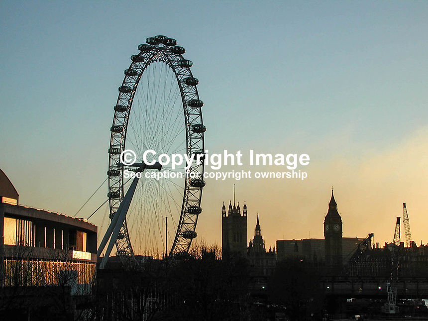 The 450 ft high London Eye, AKA Millenium Wheel, and to the right are silhouetted the Houses of Commons and Big Ben. Evening. 2001011575..Copyright Image from Victor Patterson, 54 Dorchester Park, Belfast, UK, BT9 6RJ..Tel: +44 28 9066 1296.Mob: +44 7802 353836.Voicemail +44 20 8816 7153.Skype: victorpattersonbelfast.Email: victorpatterson@mac.com.Email: victorpatterson@ireland.com (back-up)..IMPORTANT: If you wish to use this image or any other of my images please go to www.victorpatterson.com and click on the Terms & Conditions. Then contact me by email or phone with the reference number(s) of the image(s) concerned.