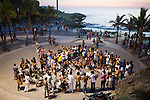 A group practices capoeira, a Brazilian art form that combines fight, dance, rhythm and movement, as a circle of people watch, at Arproador, in Rio de Janeiro, Brazil, on Saturday, Feb. 2, 2013...