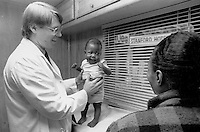(021207-SWR01.jpg) New York, NY Circa 1987 -- A 5 month old homeless infant has his first check-up by a doctor in the Mobile Medical Van. Both the infant and his mother were temporarily living in the Martinique - one of New York City's largest and most notorious Welfare Hotels. The Mobile Medical Van, which was made possible by funds from singer/songwriter Paul Simon, provides medical service for the City's Homeless living in hotels.