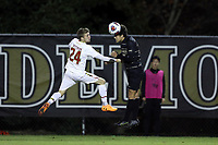 WINSTON-SALEM, NC - NOVEMBER 24: Nico Benalcazar #23 of Wake Forest University heads the ball away from Mike Heitzmann #24 of the University of Maryland during a game between Maryland and Wake Forest at W. Dennie Spry Stadium on November 24, 2019 in Winston-Salem, North Carolina.