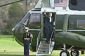 United States President George W. Bush waves from Marine One as he departs the White House in Washington, DC to spend the week-end at Camp David with First Lady Laura Bush on March 30, 2001.<br /> Credit: Ron Sachs / CNP