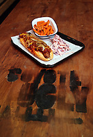 Pictured: A hot dog dish Monday 15 May 2017<br /> Re: Coyote Ugly Saloon in Cardiff, Wales, UK.