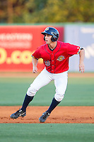 Dustin Fowler (18) of the Charleston RiverDogs takes his lead off of second base against the Greenville Drive at Joseph P. Riley, Jr. Park on May 26, 2014 in Charleston, South Carolina.  The Drive defeated the RiverDogs 11-3.  (Brian Westerholt/Four Seam Images)