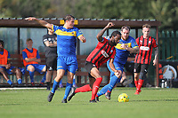 Dexter Peter of Coggeshall and George Forest of Romford during Romford vs Coggeshall Town, Bostik League Division 1 North Football at Rookery Hill on 13th October 2018
