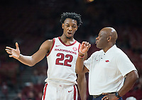NWA Democrat-Gazette/BEN GOFF @NWABENGOFF <br /> Gabe Osabuohien of Arkansas talks to head coach Mike Anderson in the second half vs Tusculum Friday, Oct. 26, 2018, during an exhibition game in Bud Walton Arena in Fayetteville.