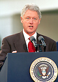United States President Bill Clinton makes remarks as he leaves the White House in Washington, DC on 31 October, 1999 for Oslo, Norway where he is to meet with Israeli Prime Minister Ehud Barak and Palestinian Leader Yasser Arafat.<br /> Credit: Ron Sachs / CNP