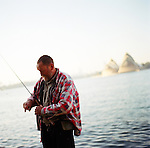 Early morning views of Sydney's Opera House, the harbor and the Harbour Bridge from North Sydney, near Luna Park. Fishermen Dave Vermeesch and Robert Jackson (plaid shirt) out for an early morning fishing session.