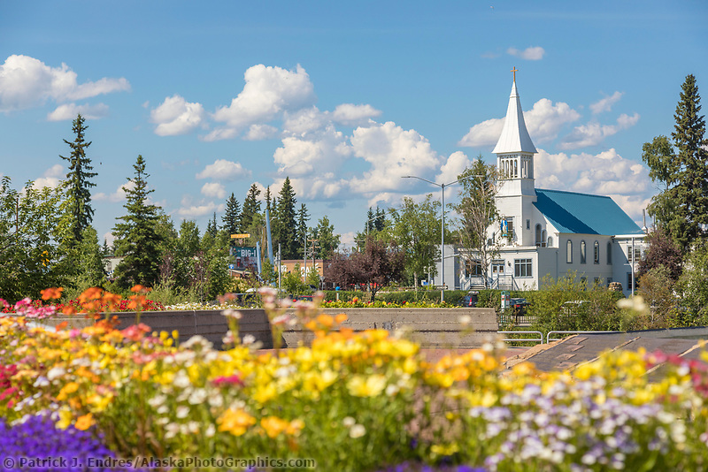 View of the Catholic Church and summer flowers from the Golden Heart Plaza in Downtown Fairbanks, Alaska