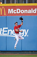 Erie SeaWolves right fielder Mike Gerber (32) jumps attempting to catch a fly ball during a game against the Richmond Flying Squirrels on August 22, 2016 at Jerry Uht Park in Erie, Pennsylvania.  Erie defeated Richmond 4-2.  (Mike Janes/Four Seam Images)