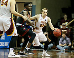 SIOUX FALLS, SD - MARCH 20: Darin Peterka #22 from Northern State tries to get a step past Kobi Nwandu #1 from East Stroudsburg during their quarterfinal game at the 2018 Elite Eight Men's NCAA DII Basketball Championship at the Sanford Pentagon in Sioux Falls, SD. (Photo by Dave Eggen/Inertia)