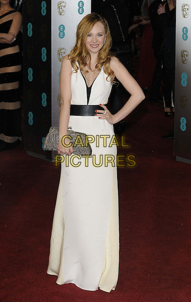 Juno Temple.EE British Academy Film Awards at The Royal Opera House, London, England 10th February 2013.BAFTA BAFTAS arrivals full length white sleeveless dress black belt hand on hip clutch bag silver  .CAP/CAN.©Can Nguyen/Capital Pictures.