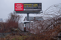 A billboard displays a notice to all travelers to Massachusetts to self-quarantine for 14 days in Medford, Massachusetts, on Mon., April 27, 2020 during the ongoing Coronavirus (COVID-19) global pandemic.