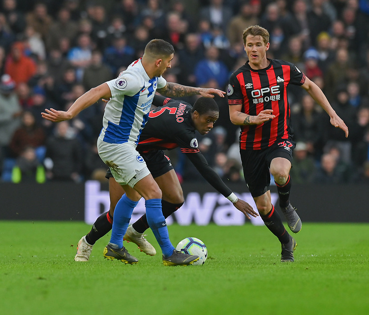 Brighton & Hove Albion's Anthony Knockaert (left) under pressure from Huddersfield Town's Terence Kongolo (centre) and Eric Durm  (right) <br /> <br /> Photographer David Horton/CameraSport<br /> <br /> The Premier League - Brighton and Hove Albion v Huddersfield Town - Saturday 2nd March 2019 - The Amex Stadium - Brighton<br /> <br /> World Copyright © 2019 CameraSport. All rights reserved. 43 Linden Ave. Countesthorpe. Leicester. England. LE8 5PG - Tel: +44 (0) 116 277 4147 - admin@camerasport.com - www.camerasport.com
