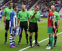 Men's Olympic Football match Honduras v Morocco on 26.7.12...Referee Pavel Kralovec at the coin toss with Driss Fettouhi of Morocco and Johnny Leveron of Honduras, during the Honduras v Morocco Men's Olympic Football match at Hampden Park, Glasgow.........