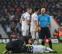 Wolverhampton Wanderers' Conor Coady (left) & Ruben Neves (centre) is discussion with referee Roger East about Wolverhampton Wanderers' Joao Moutinho who is been treated after been elbowed in the face by Bournemouth's Jefferson Lerma <br /> <br /> Photographer David Horton/CameraSport<br /> <br /> The Premier League - Bournemouth v Wolverhampton Wanderers - Saturday 23 February 2019 - Vitality Stadium - Bournemouth<br /> <br /> World Copyright © 2019 CameraSport. All rights reserved. 43 Linden Ave. Countesthorpe. Leicester. England. LE8 5PG - Tel: +44 (0) 116 277 4147 - admin@camerasport.com - www.camerasport.com
