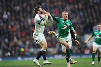 Elliot Daly of England secures the ball as Keith Earls of Ireland interferes during the NatWest 6 Nations match between England and Ireland at Twickenham Stadium on Saturday 17th March 2018 (Photo by Rob Munro/Stewart Communications)