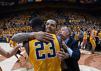Justin Cobbs of California celebrates with Jabari Bird of California after winning the game against Arizona at Haas Pavilion in Berkeley, California on February 1st, 2014.  California Golden Bears defeated Arizona Wildcats, 60-58.