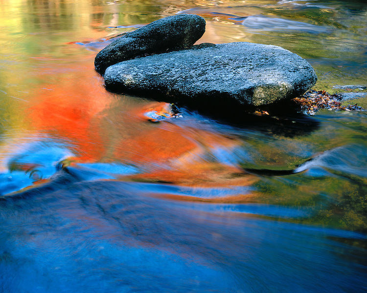 Fall color reflection and rocks in the Swift River; White Mountain National Forest, NH