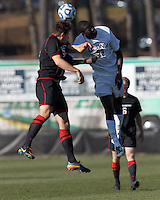 Northeastern University defender Simon Cox (5) and University of Connecticut forward Mamadou Doudou Diouf (23) battle for head ball. .NCAA Tournament. University of Connecticut (white) defeated Northeastern University (black), 1-0, at Morrone Stadium at University of Connecticut on November 18, 2012.
