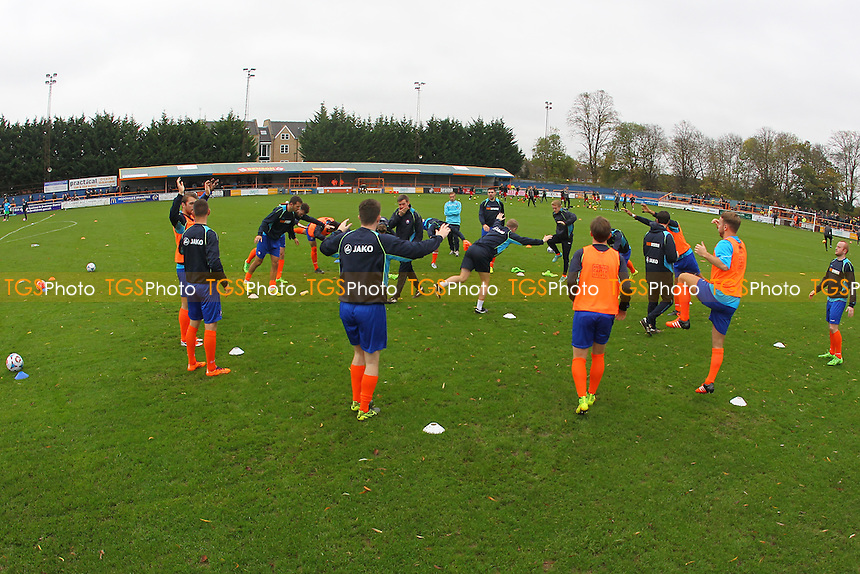 Braintree players warm up ahead of kick-off during Braintree Town vs Oxford United at the Amlin Stadium