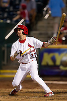 Shane Robinson (27) of the Springfield Cardinals releases his bat after hitting a home run during a game against the Tulsa Drillers at Hammons Field on July 19, 2011 in Springfield, Missouri. Tulsa defeated Springfield 17-11. (David Welker / Four Seam Images)