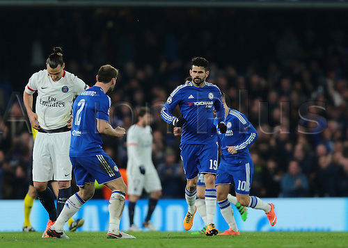 09.03.2016. Stamford Bridge, London, England. Champions League. Chelsea versus Paris Saint Germain. Chelsea Forward Diego Costa (centre) makes it 1-1, and celebrates with Chelsea Defender Branislav Ivanović, as Paris St. Germain Forward Zlatan Ibrahimović looks to the ground dejected