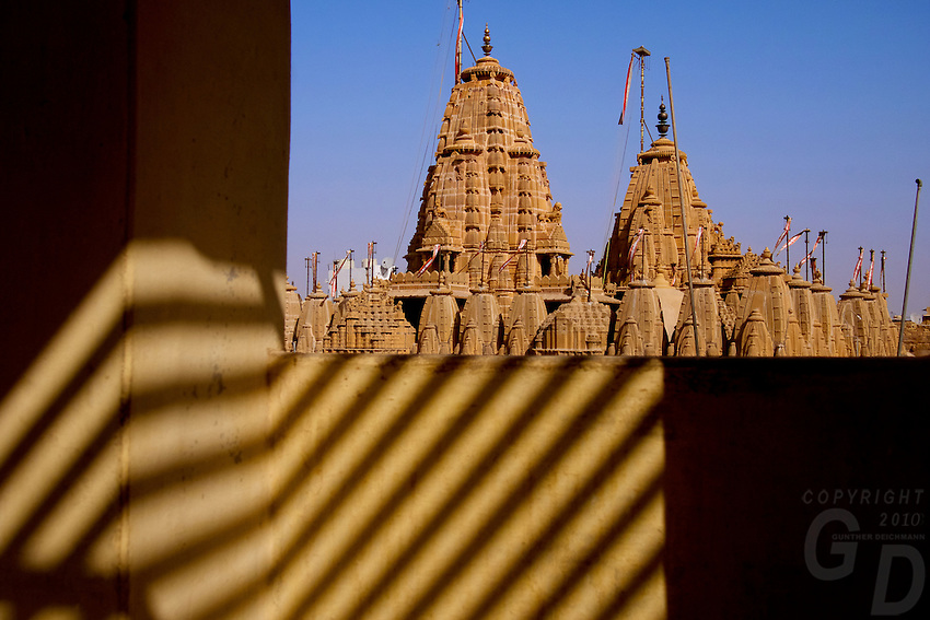 View of the Jain Temple in Jaisalmer, the &quot;Golden City,&quot; is located on the westernmost frontier of India in the state of Rajasthan. Close to the Pakistan border, the city is known for its proximity to the Thar Desert.<br /> <br /> The city is dominated by the Jaisalmer Fort, also known as Sonar Qila (Golden Fort). Unlike most forts in India, the Jaisalmer Fort is a living fort. There are shops, hotels and age old havelis (homes) inside the fort area where families have lived for generations.