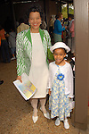 Monica Anigbogu and Camille Anigbogu at Easter services at St. Francis De Sales Catholic Church  Sunday March 23,2008.(Dave Rossman/For the Chronicle)
