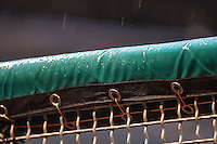 Rain hits the fence during a delay as the Salt Lake Bees faced the Fresno Grizzlies in Pacific Coast League action at Smith's Ballpark on April 13, 2016 in Salt Lake City, Utah. The Grizzlies defeated the Bees 6-0. (Stephen Smith/Four Seam Images)
