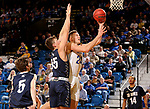 BROOKINGS, SD - NOVEMBER 1: Mike Daum #24 from South Dakota State University takes the ball to hotel basket past Mitchell Sueker #35 from South Dakota School of Mines during their exhibition game Thursday night at Frost Arena in Brookings. (Photo by Dave Eggen/Inertia)
