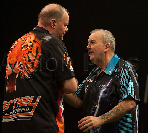 04.02.2016.  First Direct Arena, Leeds, England.  Betway Premier League Night One.  Phil Taylor [ENG] congratulates Raymond van Barneveld [NED] after their match.