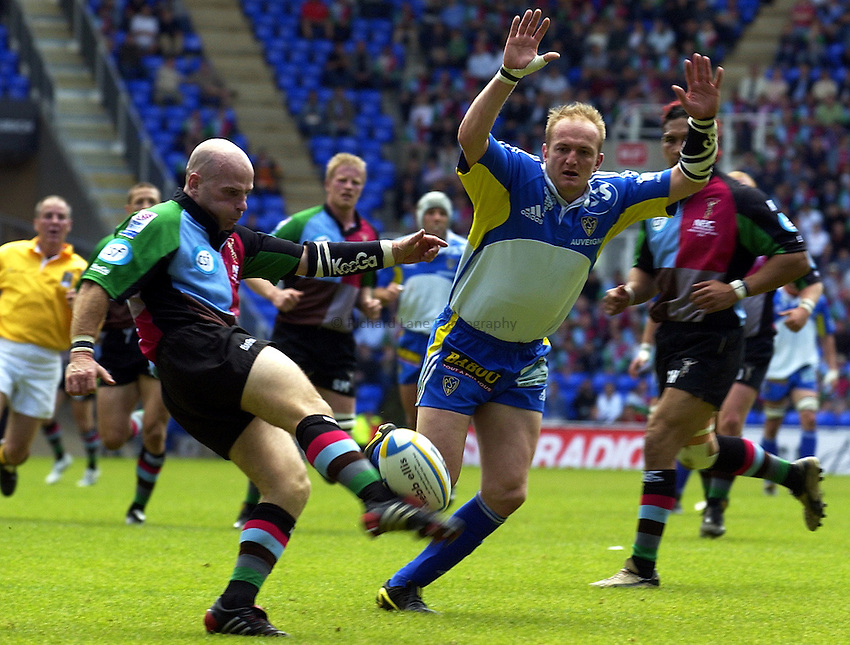 Photo. Henry Browne..22/05/2004..Montferrand v NEC Harlequins Parker Pen Challenge Cup Final...Paul Burke kicks for safety.