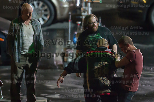 US actor Bruce Willis (L) watches as Irish director John Moore (top R) directs members of the crew during the rehearsal of a fight schene on set during a shooting of their next movie fifth in the Die Hard series titled Good Day to Die Hard in Budapest, Hungary on July 10, 2012. ATTILA VOLGYI